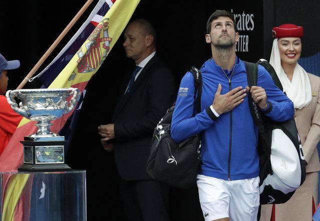 Serbia's Novak Djokovic reacts as he arrives onto Rod Laver Arena for the men's singles final against Spain's Rafael Nadal at the Australian Open tennis championships in Melbourne, Australia, Sunday, Januaru 27, 2019. (Photo by Aaron Favila/AP Photo)