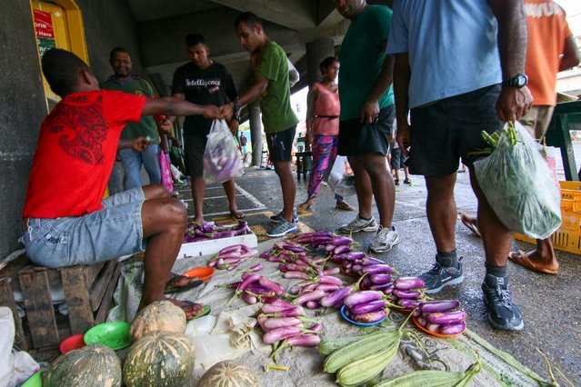 Locally-grown fruits and vegetables are bought at an open air market in Fiji's capital Suva following Cyclone Winston, February 22, 2016. (Photo by Steven Saphore/Reuters)