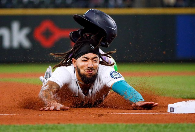 Seattle Mariners shortstop J.P. Crawford slides into third to advance on a sacrifice fly against the Oakland Athletics during the third inning at T-Mobile Park, September 28, 2021. (Photo by Joe Nicholson/USA TODAY Sports)