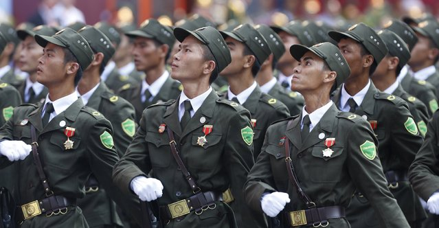 Village policemen march during a military parade as part of the 40th anniversary of the fall of Saigon in Ho Chi Minh City (formerly Saigon), Vietnam, April 30, 2015. (Photo by Reuters/Kham)
