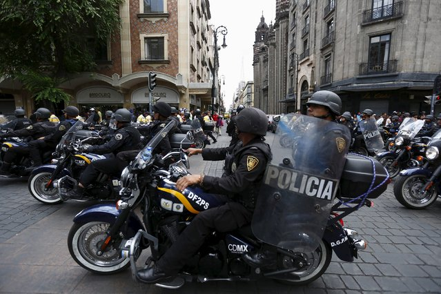 Police officers on motorcycles watch over a march for Labor Day in Mexico City May 1, 2015. (Photo by Edgard Garrido/Reuters)