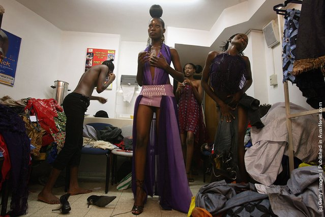 Nigerian fashion models are made up for their fashion show to promote ethnic fashion June 13, 2006 in Tel Aviv, Israel
