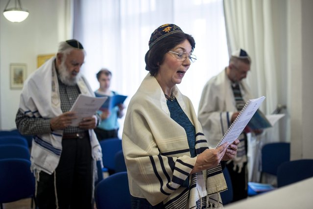 Hungary's only female rabbi Katalin Kelemen (C) prays during a Shabbath service in the synagogue of the Sim Shalom Progressive Jewish Congregation in central Budapest, Hungary, 05 March 2016. (Photo by Bea Kallos/EPA)