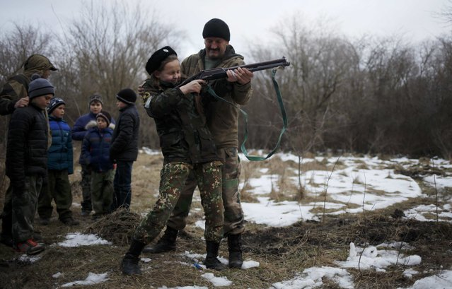 Students of the General Yermolov Cadet School and members of a local youth military patriotic club undergo military training at a boot camp of the Russkiye Vityazi (Russian Knights) military patriotic club in the village of Sengileyevskoye outside Stavropol, Russia February 8, 2017. (Photo by Eduard Korniyenko/Reuters)