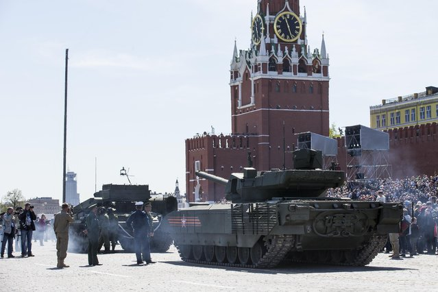 A  Russian T-14 Armata tank is ready to be towed in Red Square during a preparation for general rehearsal for the Victory Day military parade which will take place at Moscow's Red Square on May 9 to celebrate 70 years after the victory in WWII, in Moscow, Russia, Thursday, May 7, 2015. (Photo by Alexander Zemlianichenko/AP Photo)