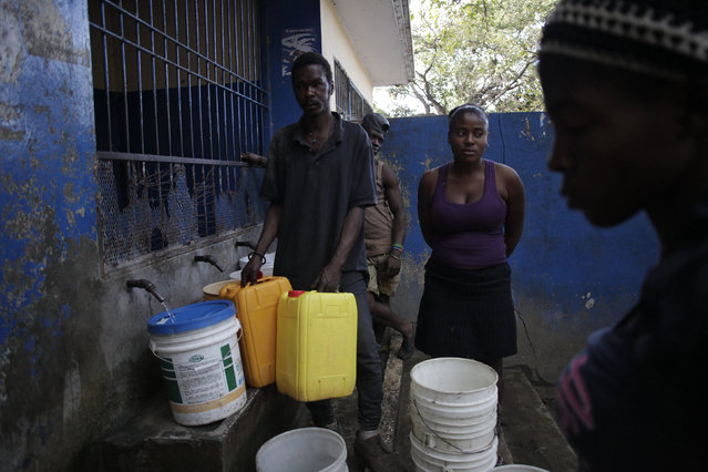 Haitians fill containers at a water kiosk in Port-au-Prince, Haiti, March 8, 2016. March 22 marks World Water Day. (Photo by Andres Martinez Casares/Reuters)