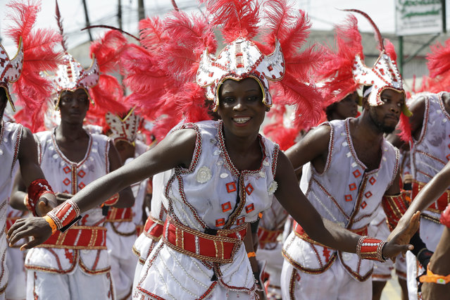 Performers dance through the street during the Lagos Carnival, Nigeria, Saturday May 9, 2015. (Photo by Sunday Alamba/AP Photo)