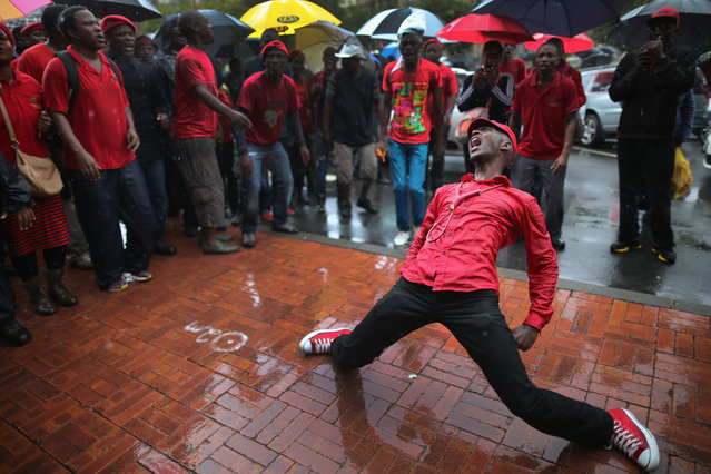 Supporters of the Economic Freedom Fighters (EFF) rally and sing songs outside Pretoria High Court on March 4, 2014 in Pretoria, South Africa. The EFF are saying that the R600,000 deposit required when submitting candidates names for the upcoming national elections are unjust and are seeking an interdict in court against it. (Photo by Christopher Furlong/Getty Images)