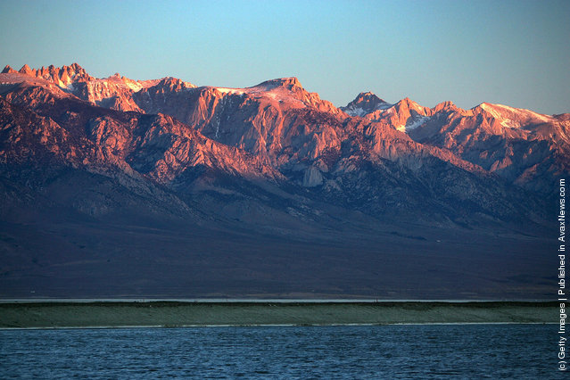 The Sierra Nevada Mountains rise to more than 14,000 feet in elevation behind Owens Lake, fed by the snows of the Sierras which are currently lower than one-fifth its normal depth