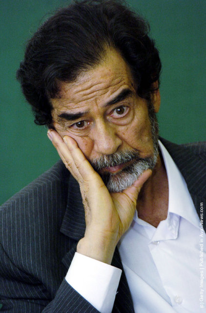 Saddam Hussein is questioned by an investigating Judge