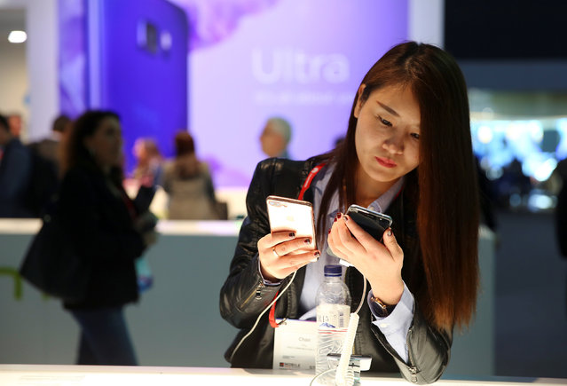 A woman views the new HTC U Ultra at the HTC stand at the Mobile World Congress in Barcelona, Spain March 1, 2017. (Photo by Paul Hanna/Reuters)