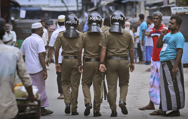 Sri Lankan policeman patrol in a Muslim neighborhood before Friday prayers in Colombo, Sri Lanka, Friday, April 26, 2019. Across Colombo, there was a visible increase of security as authorities warned of another attack and pursued suspects that could have access to explosives. Authorities had told Muslims to pray at home rather than attend communal Friday prayers that are the most important religious service for the faithful. At one mosque in Colombo where prayers were still held, police armed with Kalashnikov assault rifles stood guard outside. (Photo by Manish Swarup/AP Photo)