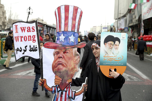 In a February 11, 2019 file photo, an Iranian woman holds an effigy of US president Donald Trump, during a rally marking the 40th anniversary of the 1979 Islamic Revolution, in Tehran, Iran. Iranian President Hassan Rouhani is reportedly set to announce Wednesday, May 8, 2019, ways the Islamic Republic will react to continued U.S. pressure after President Donald Trump pulled America from Tehran's nuclear deal with world powers. (Photo by Ebrahim Noroozi/AP Photo/File)