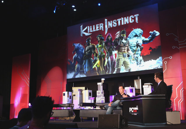 Phil Spencer, Head of Xbox, left, announces Killer Instinct coming to Windows 10 at the Xbox-sponsored PC Gaming Show on Tuesday, June 16, 2015 in Los Angeles. (Photo by Casey Rodgers/Invision for Microsoft/AP Images)