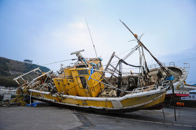 A fishing boat is washed onto the ground on March 20, 2011 in Asahi, Chiba, Japan. The 9.0 magnitude strong earthquake struck offshore on March 11 at 2:46pm local time, triggering a tsunami wave of up to ten metres which engulfed large parts of north-eastern Japan. The death toll continues to rise and could well reach 10,000 in a tragedy not seen since World War II in Japan.  (Photo by Koki Nagahama/Getty Images)