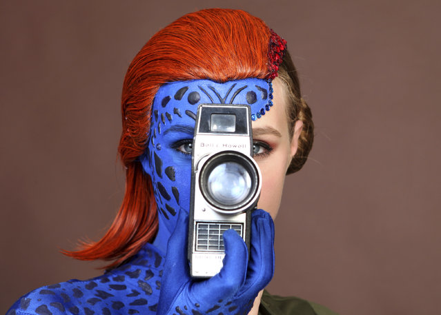 Evy Thomas, dressed as Mystique, poses for a portrait on day one of Comic-Con International on Thursday, July 18, 2019, in San Diego. (Photo by Rebecca Cabage/Invision/AP Photo)