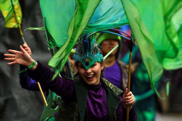 A participant waves during the St. Patrick's day parade in Dublin, Ireland on March 17, 2017. (Photo by Clodagh Kilcoyne/Reuters)