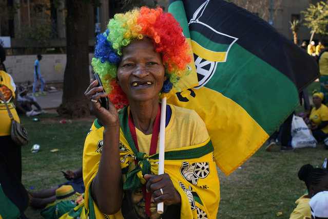 African National Congress party (ANC) supporters gather at the ANC's headquarters in Johannesburg, South Africa, Sunday May 12, 2019 to celebrate their party's victory in South Africa's general election. President Cyril Ramaphosa is expected to address the rally. (Photo by Jerome Delay/AP Photo)