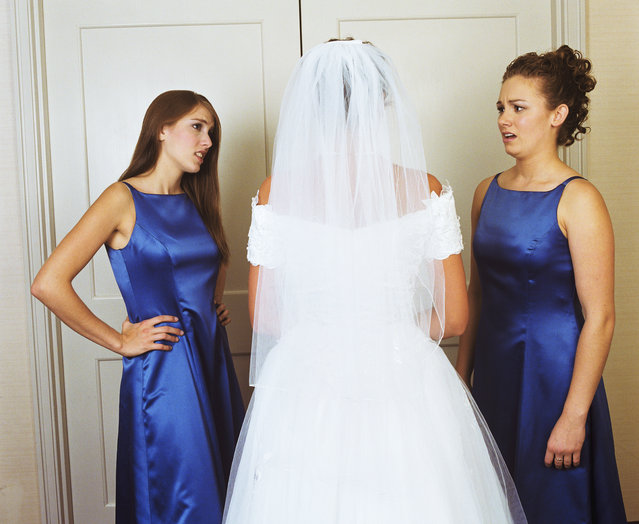 Bride with bridesmaids in Traverse City. Michigan, USA, rear view. (Photo by Greg Ceo/Getty Images)