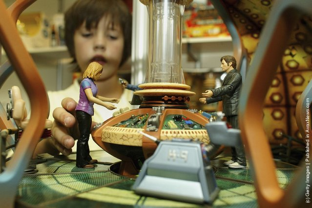 A boy plays with a Dr Who tardis toy at the Deram Toys 2006 exhibition
