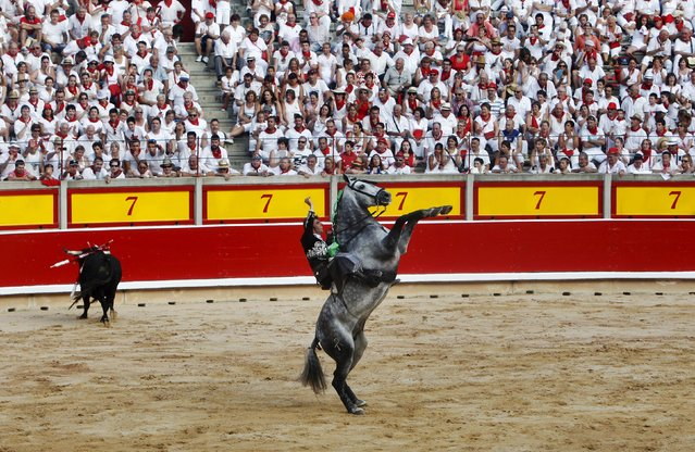 Spain's rejoneador (bullfighter on horseback) Roberto Armendariz reacts after fighting a bull in the bullring on the first day of the San Fermin festival in Pamplona, Spain, July 6, 2015. (Photo by Reuters/Stringer)