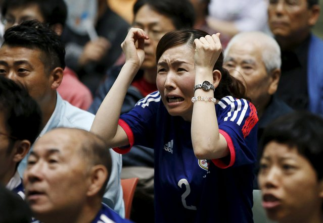 A Japan soccer fan reacts as she watches Japan's FIFA Women's World Cup final match against the U.S. in Vancouver, at a public viewing event in Tokyo, Japan, July 6, 2015. Japan lost the match 5-2 to the U.S. (Photo by Toru Hanai/Reuters)