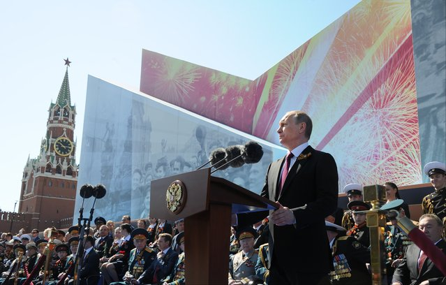 Russian President Vladimir Putin speaks during the Victory Day military parade marking 71 years after the victory in WWII in Red Square in Moscow, Russia, Monday, May 9, 2016. (Photo by Mikhail Klimentyev/Sputnik, Kremlin Pool Photo via AP Photo)