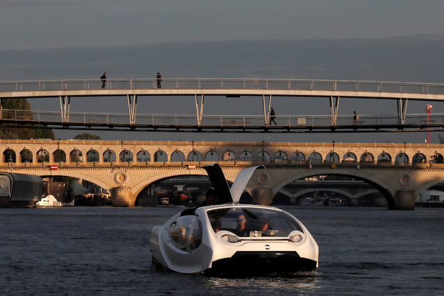 The Bubbles water taxi is seen on the River Seine during a demonstration by the SeaBubbles company in Paris, France, September 16, 2019. (Photo by Gonzalo Fuentes/Reuters)