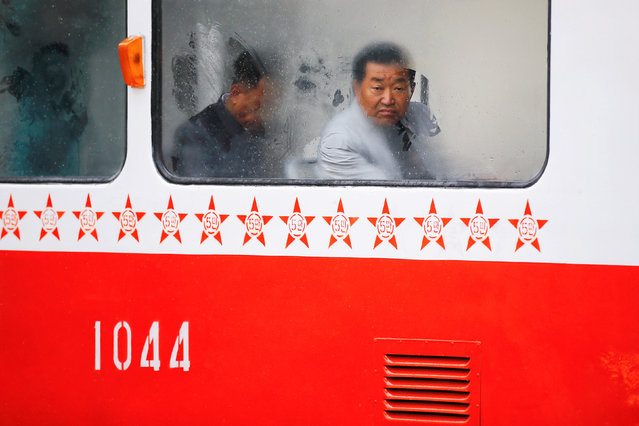 A man looks through a foggy window of a tram on a rainy day in central Pyongyang, North Korea April 14, 2017. (Photo by Damir Sagolj/Reuters)