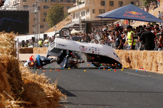 Competitors crash while driving their homemade vehicle without an engine during the Red Bull Soapbox Race in Amman, Jordan on September 20, 2019. (Photo by Muhammad Hamed/Reuters)