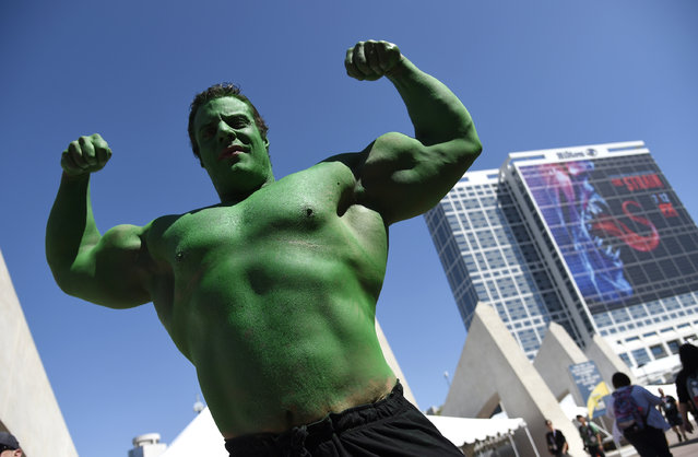 Nicholas DeCapria of Philadelphia, dressed as the Hulk, collects donations for his son Vhito DeCapria, who is battling pediatric cancer, on day 2 of Comic-Con International on Friday, July 10, 2015, in San Diego, Calif. (Photo by Chris Pizzello/Invision/AP Photo)