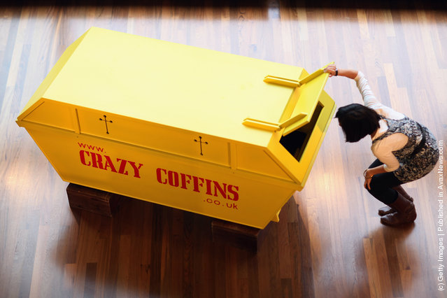 A coffin in the shape of a skip