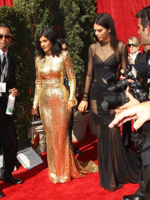 Kylie Jenner, left, and Kendall Jenner arrive at the ESPY Awards at the Microsoft Theater on Wednesday, July 15, 2015, in Los Angeles. (Photo by Paul A. Hebert/Invision/AP Photo)