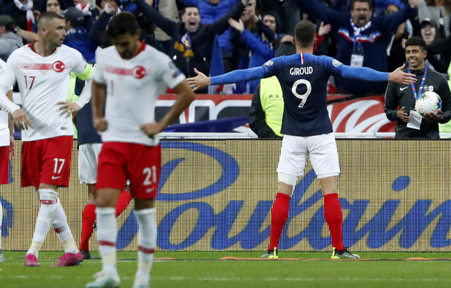 France's Olivier Giroud celebrates his goal against Turkey during the Euro 2020 group H qualifying soccer match between France and Turkey at Stade de France at Saint Denis, north of Paris, France, Monday, October 14, 2019. (Photo by Thibault Camus/AP Photo)