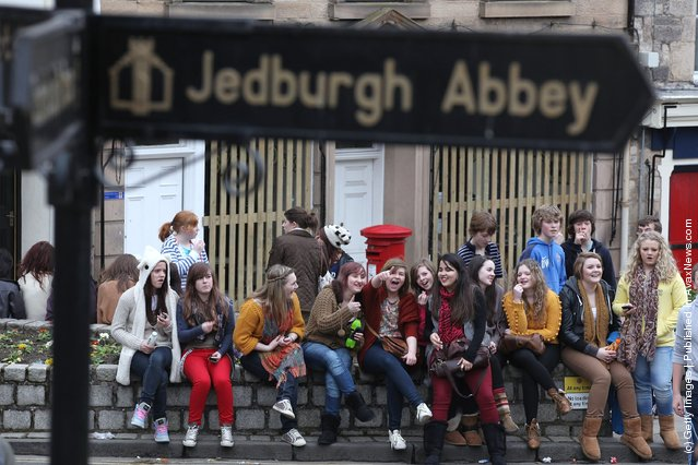 Girls gather to watch the annual 'Fastern Eve Handba' event in Jedburgh's High Street in the Scottish Borderson March
