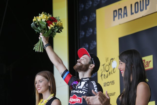Stage winner Germany's Simon Geschke celebrates on the podium of the seventeenth stage of the Tour de France cycling race over 161 kilometers (100 miles) with start in Digne-les-Bains and finish in Pra Loup, France, Wednesday, July 22, 2015. (Photo by Christophe Ena/AP Photo)