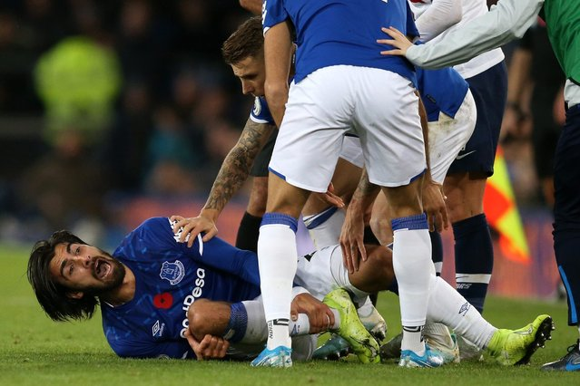 Andre Gomes of Everton reacts after being tackled by Son Heung-Min of Tottenham Hotspur during the Premier League match between Everton FC and Tottenham Hotspur at Goodison Park on November 03, 2019 in Liverpool, United Kingdom. (Photo by Jan Kruger/Getty Images)