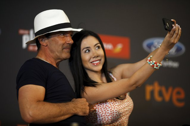 A journalist takes a selfie with Spanish actor and director Antonio Banderas after she gave him a hat during a news conference on the eve of the second Premios Platino Ibero-American Film Awards, where he will be awarded with the Premio Platino de Honor (Platinum Award of Honor) for Lifetime Achievement, in Marbella, southern Spain, July 17, 2015. (Photo by Jon Nazca/Reuters)