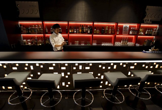 A waiter works in a bar at First Cabin hotel, which was converted from an old office building, in Tokyo, July 3, 2015. (Photo by Toru Hanai/Reuters)