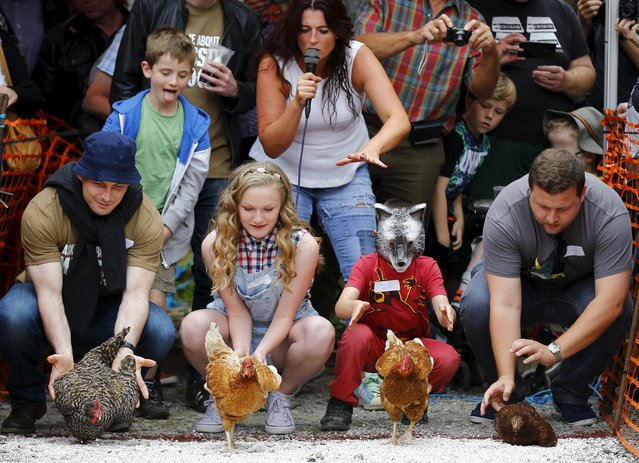 Competitors release their hens during the World Championship Hen Racing Championships in Bonsall, Britain August 1, 2015. (Photo by Darren Staples/Reuters)