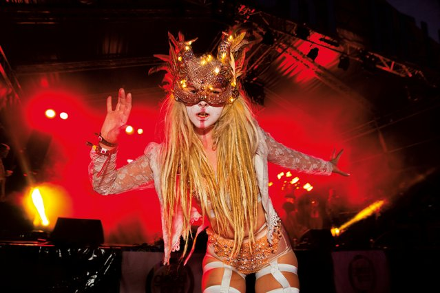 The theme for the 2015 Shangri-La was Protest. Masked dancer by the Hell stage. (Photo by Barry Lewis/The Guardian)