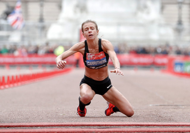 Great Britain's Hayley Carruthers collapses before the finish line in the women's race at the 39th London Marathon in London, Sunday, April 28, 2019. (Photo by Alastair Grant/AP Photo)