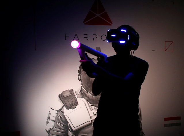A man plays a game using the new Sony VR headset during Sony Corporation's PlayStation 4 E3 2016 event in Los Angeles, California, U.S. June 13, 2016. (Photo by Mike Blake/Reuters)