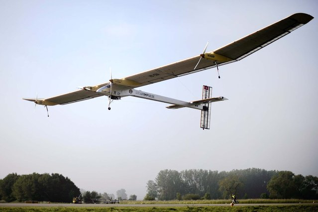 Company CEO Andre Borschberg pilots the experimental aircraft Solar Impulse  for its first intercontinental flight to Morocco from an airbase in Payerne, Switzerland on May 25, 2012
