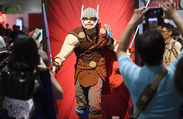 Comic-Con attendees photograph a life-size Lego statue of the superhero character Thor during Preview Night of the 2017 Comic-Con International on Wednesday, July 19, 2017, in San Diego, Calif. (Photo by Chris Pizzello/Invision/AP Photo)