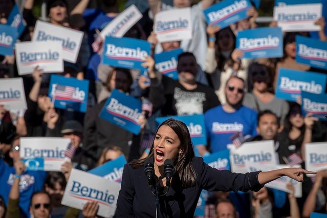 """US Democratic Representative Alexandria Ocasio-Cortez of New York appears at a """"Bernie's Back"""" rally for US Democratic Senator of Vermont and Presidential Candidate Bernie Sanders in the Queens borough of New York, New York, USA, 19 October 2019. (Photo by Gary He/EPA/EFE)"""