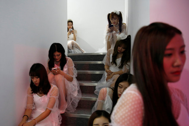 Girls rest on stairs at the China Digital Entertainment Expo and Conference (ChinaJoy) in Shanghai, China July 27, 2017. (Photo by Aly Song/Reuters)