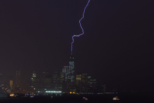 Lightning strikes One World Trade Center in Manhattan as it is seen from Weehawken during a summer storm over New York, July 14, 2014. (Photo by Eduardo Munoz/Reuters)