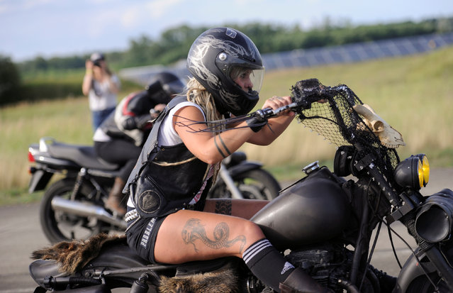 Participants ride motorbikes during a race at the women-only Petrolettes motorcycle festival in Neuhardenberg near Berlin, Germany on July 29, 2017. (Photo by Stefanie Loos/Reuters)