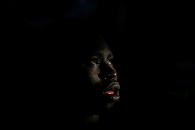 A migrant listens to instructions from Migrant Offshore Aid Station (MOAS) personnel on the MOAS ship Topaz Responder after being rescued around 20 nautical miles off the coast of Libya, June 23, 2016. (Photo by Darrin Zammit Lupi/Reuters)